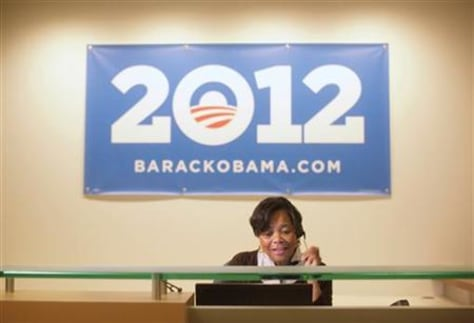 Volunteer receptionist answers the phone at President Obama's new campaign headquarters in Chicago