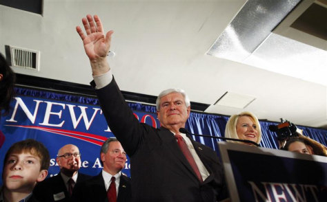 Republican U.S. presidential candidate Gingrich waves to the crowd with his wife Calista at right at his South Carolina primary election night rally in Columbia