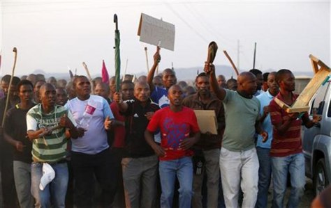 Image: Striking platinum mineworkers at Lonmin's Marikana mine in South Africa's North West Province