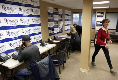Volunteers work the phones at a Romney/Ryan office as each party gets in their last efforts the day before election day in Wauwatosa
