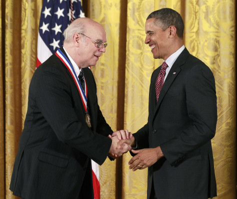 U.S. President Obama shakes hands with National Medal of Technology and Innovation recipient Dr. Norman McCombs from AirSep Corporation during