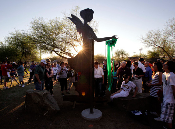 Image: People gather around a statue built in memory of Christina-Taylor Green