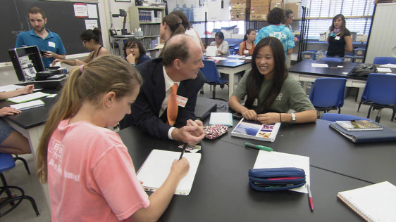 Image: Michael Marder, center, is a physics professor at the University of Texas-Austin who leads the UTeach program