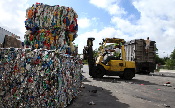 Image: A forklift operator stacks bales of sorted recyclable materials