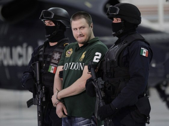 "Image: Edgar ""La Barbie"" Valdez is escorted by Mexican federal police"