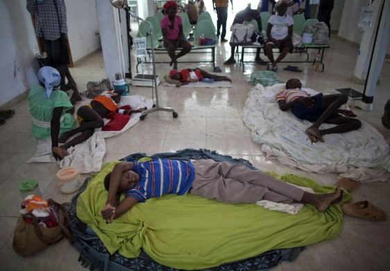 Image: People suffering cholera symptoms rest in a hospital