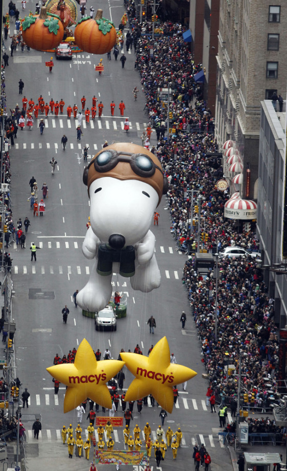 Image: Balloons pass through Times Square during the 84th annual Macy's Thanksgiving Day parade in New York