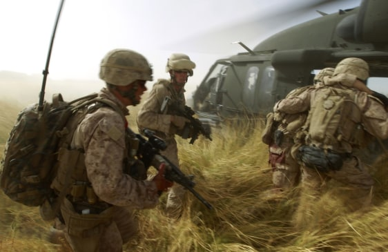 Image: Marines help wounded comrade in Afghanistan.