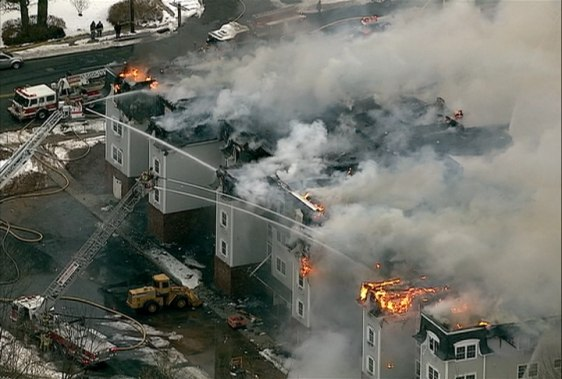 Image: Firefighters battle flames at an apartment complex