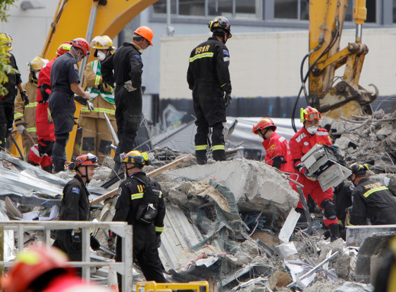 Image: Workers sift through the rubble of CTV building