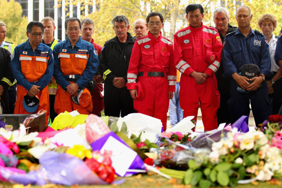 Image: Rescue workers observe two minutes of silence