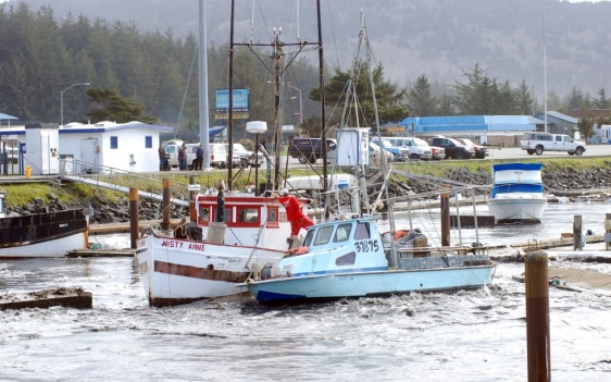 Image: A loose boat slams into another in the boat basin at Crescent City, Calif.