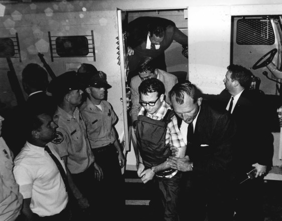 Image: James Earl Ray is escorted to the Shelby County Jail