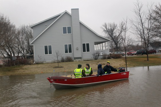 Image: Cass County Sheriff's Deputies head out to check on residents living in a flooded rural area April 10