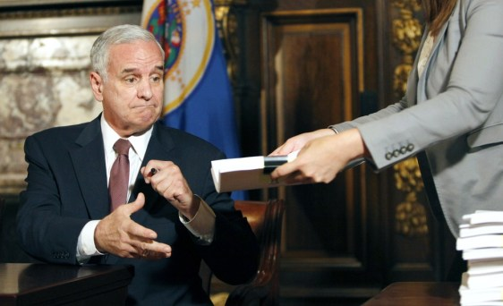 Image: Minnesota Gov. Mark Dayton signs budget bill