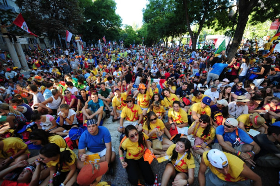 Image: Pilgrims wait near Cibeles square in Madrid