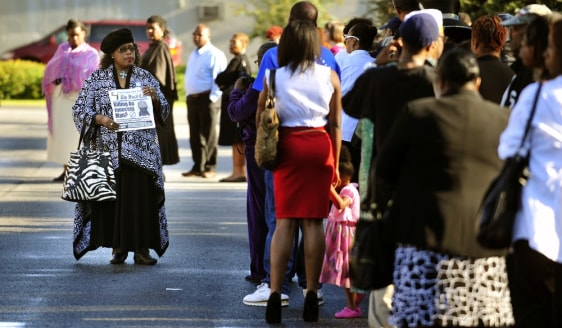 Image: People wait for the funeral of Troy Davis