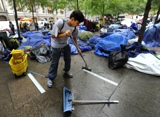 Image: Demonstrators at Zuccotti Park start cleaning belongings