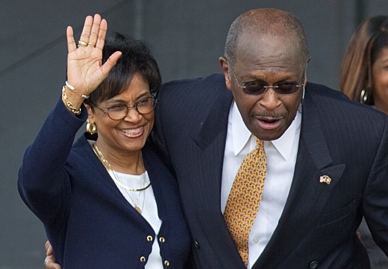 Image: Gloria Cain accompanies her husband Herman Cain as he announces his run as a Republican candidate for president in Atlanta, May 21.