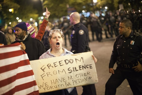 Image: Amy Barnes protests as police move in to clear a downtown street during an Occupy Atlanta demonstration