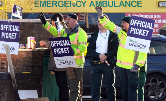 Image: Workers picket outside the Bournbrook Ambulance Station during a public sector strike over pensions in Birmingham, England.
