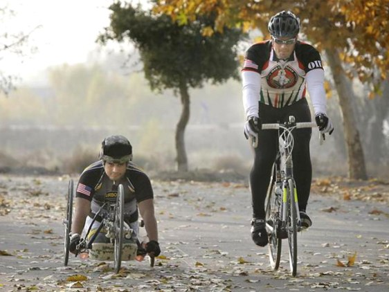 Image: Wesley Barrientos and Jeremy Staat on bicycles