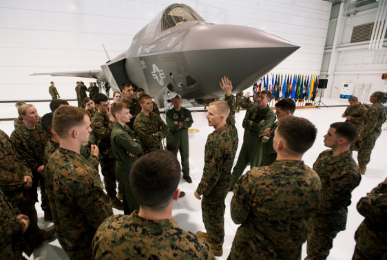 Image: Major Mike Rountree, a marine fighter attack training officer, shows naval flight students a U.S. Marine F-35B Joint Strike Fighter Jet during a roll-out ceremony at Eglin Air Force Base in Florida