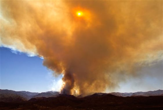 Image: A wild fire continues to burn near the historic town of Crown King, Arizona