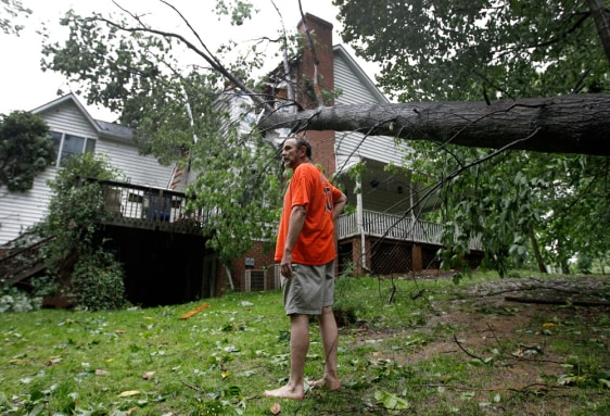Image: Doug Swinton looks at damage to his home