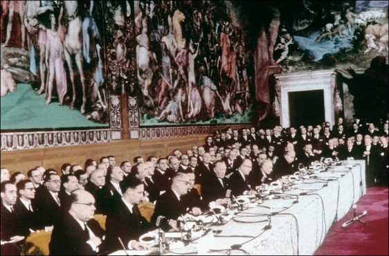 Image: A picture taken on March 25, 1957 in Rome shows foreign affairs ministers signing the treaties creating the European Economic community (EEC) and the Euratom.