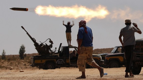 Image: Anti-Gadhafi fighters fire a multiple rocket launcher near Sirte