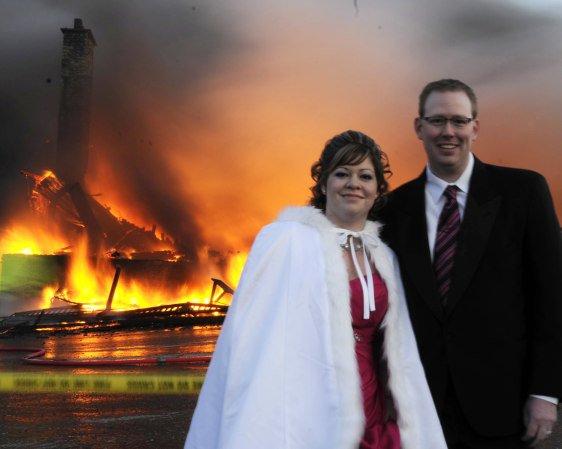 Image: Michael and Nancy Rogers on their wedding day with flames in background