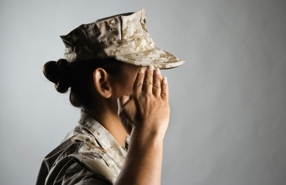 Image: Profile of a female United States Marine saluting, veteran