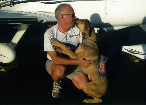 Image: Pilot Jeff Bennett with a rescued dog