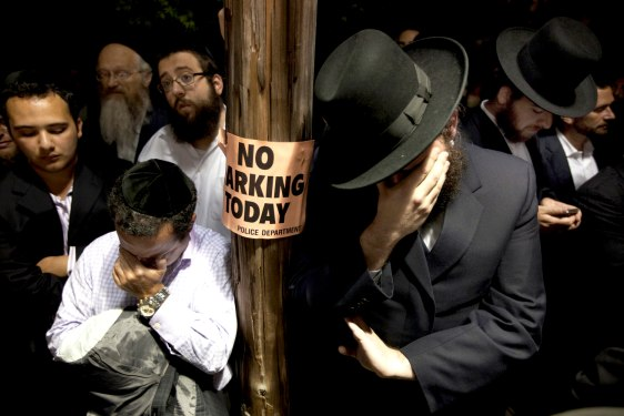 Image: Men weep outside funeral of Leiby Kletzky in Brooklyn