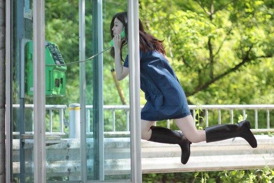 Image: Natsumi Hayashi levitating in a phone booth