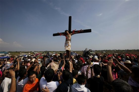 Image: Man hangs on cross