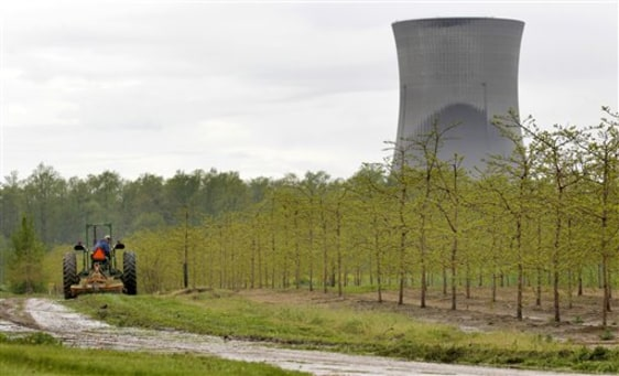 Image: A tree farm in North Perry, Ohio, near the two cooling towers of the Perry Nuclear Power Plant