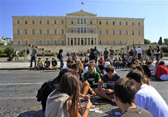Image: High school students block a main avenue in Athens