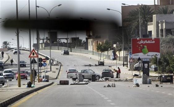 Image: Roadblock seen through car windscreen in Tripoli