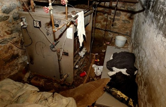 Image: The dank basement room in Philadelphia in which four weak and malnourished mentally disabled adults were found locked up