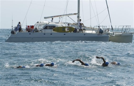 Image: Japanese athletes swimming to Taiwan