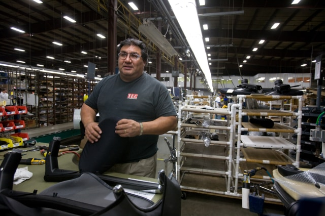 Image: Worker at chair assembly plant in Elkhart County