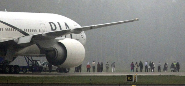 Image: Passengers are evacuated from jet in Sweden