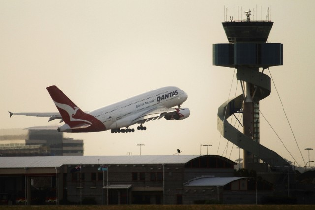 Image: A Qantas A380 superjumbo takes off at Mascot Airport in Sydney