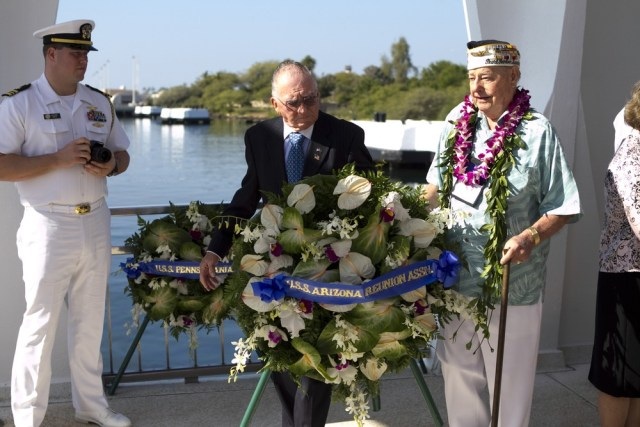 Image: Don Stratton, Louis Conter lay wreath at Arizona Memorial