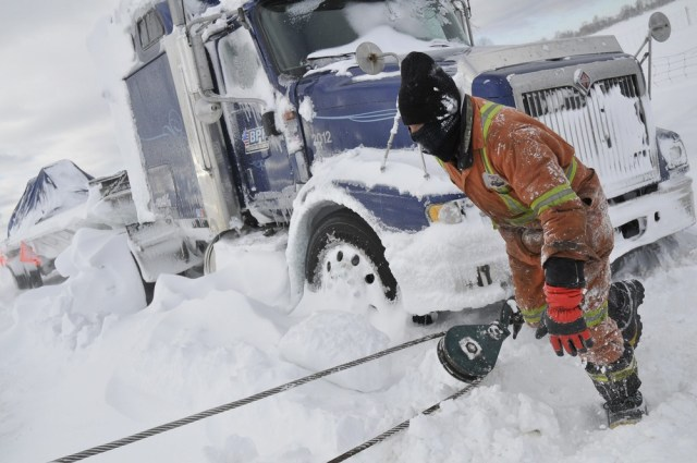 Image: Truck towed out of snow in Canada