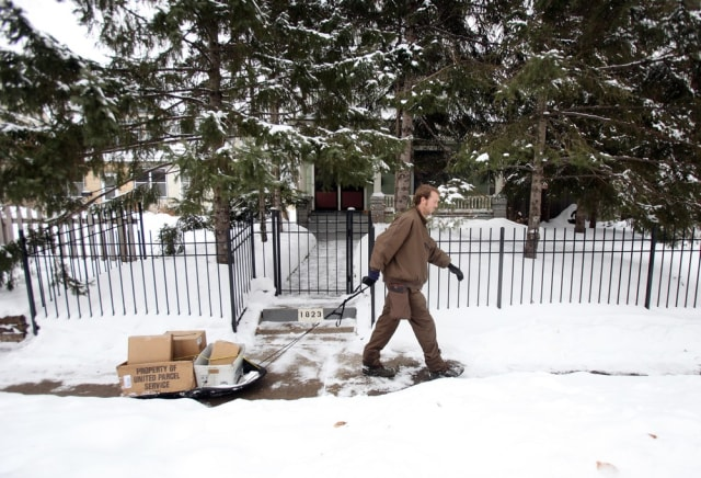 Image: UPS employee pulls a sled