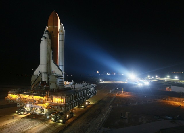 Image: Space Shuttle Discovery Rolls Out To Launch Pad For Final Mission