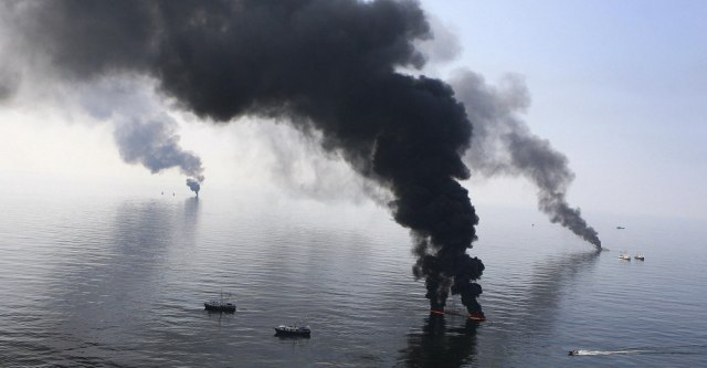Image: File photo of smoke billowing from a controlled burn of spilled oil off the Louisiana coast in the Gulf of Mexico coast line